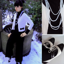 Aga K. - H&M Cardigan With Bows, Pearls, Office London Jazz Brogues, H&M Black Bodysuit - Spirit of Coco