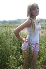 Jodi Swiney - White Tee, Pink And Gray Floral Print Shorts - We were born before the wind.