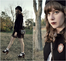 Maria C. - Super Duper Things Stag Shield Brooch, Jeffrey Campbell Splendid Clogs, Delightful Dozen Brown Lace Skirt, Black Jacket, Asos Brown Purse, Urban Outfitters White Pointelle Socks, Urban Outfitters Old Beret - Black and Brown