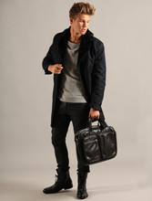 Andreas Wijk - Filippa K Jacket, Acne Studios Bag - Collar for a cold day.