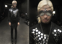 Andre Judd - Hong Kong Silver Flat Components Heat Pressed Onto A Shirt, Protacio Collarless Tunic, Silver Aviators With Silver Flash, Crystal Pendant Worn As Headpiece, H&M Black Stetched Booties - SILVER SURFER