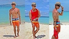 Kutik T - Local Market Straw Fedora, Oakley Five, Springfield Wooden Bead Bracelets, Mossimo Board Shorts, Folded And Hung Red Knitted Vest - Boracay sun