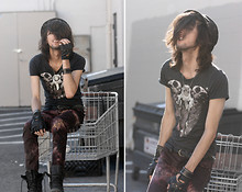 Bobby Raffin - Nebula Skull Upside Down Triangle Shirt, Steampunk Gear Necklace, Snake Print Skinny Jeans, Black Market Combat Boots, Bang On! Leather Biker Gloves, Circle Stud Bracelet, Leather Braided Belt - Sick like Sid and Nancy.