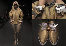 Andre Judd - Aries Lagat Lantern Sleeve Jacket With Floral Cutouts At Back, Vintage Lurex Mesh Jacket Worn As Inner Shirt, Gold,Bronze,Metallic Grey Bow Bracelets Stacked, Gold Leather Pointed Brogue Sneakers, Pearl With Metal Hybrid Choker, Quality Quidditch Supplies Golden Snitch - GOLDEN SNITCH