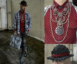 Andre Judd - Don Protasio Greek Inspired Sandal Boots, Vintage Scarf Print Silk Jacket, Protacio Metallic Gray Pinstripe Trousers, Checkered Folio Case, Polka Dotted Shirt, Vintage And Hk Beaded Jewelry, Enrico Carado Custom Made Modified Stetson With Leather Combi - SUPERPOWER