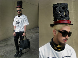 Andre Judd - Protacio Drop Crotch Trousers, Biker Boots, Gold And Antique Brass Jewelry, Paris Linen Printed Top, Black Button Down Shirt, Gold Choker Necklaces, Black Frames With Mirror Tint, Enrico Carado Custom Handmade Tophat, Croc Skin Tote - PARIS, JE T'AIME
