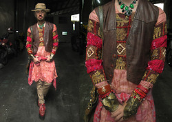 Andre Judd - Faux Croc Skin Tote, Elevated Flaform Brogues, Viktor Beige Dropcrotch Trousers, Vintage Indian Tunic With Gold Embroidery, Intarsia Knit Cardigan Wrapped Around Waist, Enrico Carado Cuffs, Vintage Leather Vest, Emerald Colored Stones, Woven Cowboy Hat - Cowboys and Indians