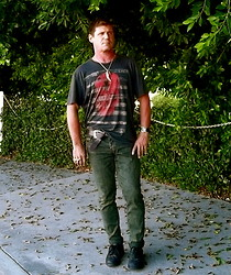 Rad Runner - Buddha & Big Kitty Tooth, Worn Skull Tee, From My Daughter Sportwatch & Big Kitty Ring, Brown Leather Belt, Green Rolled Skinnies, Black Leather Tennies - Skullduggerous