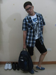 CM Fabian - Sm Department Store Eyeglasses, Artwork Graphic T Shirt, Dansen Blue Plaid Polo, Maldita Man Black Shorts, Happy Feet Blue Slip On Shoes, The North Face Blue Backpack - Nerdy Backpacker