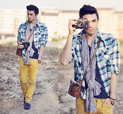 James Vyn -  - Blue shirt and Camel pants
