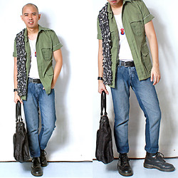 Chris Dela Cruz - Hermës Leather Bracelet, Dr. Martens Army Boots, Salvatore Mann Black Bag, Black Leather Belt, Vintage Army Jacket, Bench White Tank Top, Folded And Hung Blue Jeans, Tag - Shopping for the army.