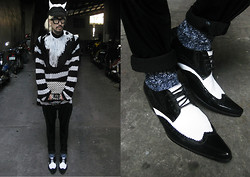 Andre Judd - Volume Trousers, Woven Leather Clutch, Striped Knit Sweater, Cotton Fringe Neckpiece, Marled Socks, Pointed Patent Oxfords, Black White Knit Horned Cap With Knit Pompom - WHERE THE WILD THINGS ARE