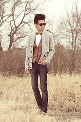 Jeremy Cunanan - Thrift Brown Leather Vest, Self Made Fish Bowtie, Steve Madden Brown Leather Buckled Loafers, Ray Ban Classic Tortoise Wayferer, Michel Kors White Button Up, H&M Gray Chunky Shawl Cardigan, Bullhead Dark Skinny Jeans - Leather Vest and Self-Made Bowtie