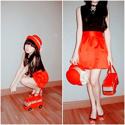 Cynthia Ciputra -  - It's red. it's the bloody living doll.