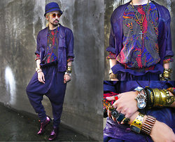 Andre Judd - Rounded Frames, Vintage Silk Bomber Jacket With Paisley Print, Vintage 80s Rounded Padded Shoulder Leather Jacket, Selection Of Gold, Bangles And Silver Accessories, Protacio Purple Paperbag Waist Trousers, Vintage Cloche Hat, Lanvin Metallic Leather Laceups - PURPLE PASSIONFRUIT