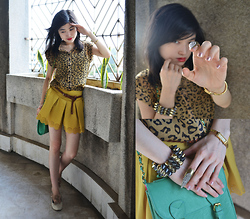Kayley See - Green Satchel, Cheetah Print Collared Top, Mustard Shorts With Laced Cut Out Bottom, Claw Ring, Spiked Cuff, Gucci Gold Watch - Animal Instinct