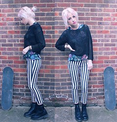 Lucy Rance - Asos Cross Jumper, Topshop Floral Top, H&M Jeans, Dr. Martens Boots - Bad girls do it well