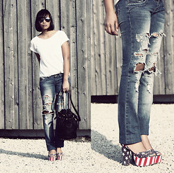 Anjelica Lorenz - Jeffrey Campbell Stars & Stripes Sandals, Stradivarius Jeans, Alexander Wang Diego Bucket Bag - RIPPED.