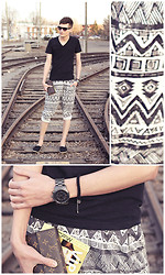 Andrew Eirich - American Apparel Black V Neck Shirt, H&M Cuffed Tribal Pant, Michael Kors Mk Gunmetal Watch W/ Glitz, Louis Vuitton Sarah Wallet, H&M Black Espadrilles, Prada Black/Clear Wayfarer - Tribes + Trains.