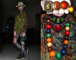 Andre Judd - Yellow Resin Ring, Handwoven Hat, Cotton Check Button Down Shirt, Angular Frames Glasses, Camera Bag, Floral Print Leggings, Vintage Leaves Print Vest, Wooden Beaded Necklace, Coral Silver Choker Neckpiece, Coral Ring, Brown Enamel Ring, Hiking Booties, Tiger Print Ring - HYPERTROPIC