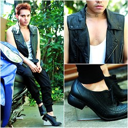 Karl Philip Leuterio - Jeffrey Campbell Up End Brogue Lucite Wedge, Giordano Concepts Cargo Skinny, K Russ Leather Vest, Miadore Acrylic Cuff, Anne Solomon Acrylic Choker - Walking on air