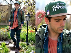 Adrian S. - Asos Triangle Necklace, The Hundreds Snapback, Cheap Monday Tee, Nudie Jeans Shirt, G Star Camouflage Jacket, Cheap Monday Black Skinny Jeans, Bullboxer Boots - The Hundreds