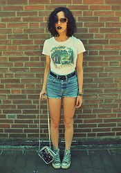 Poppy Lee Jones - A.J. Morgan Pink Cat Eye Shades, Beatles Store In Liverpool Shirt, Thrifted Belt, Levi's® Jeans Shorts, Converse Chucks, Thrifted See Through Bag -  like some childish demon who keeps insects on a string