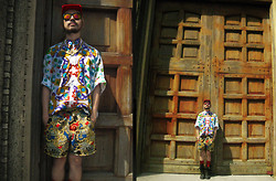 Andre Judd - River Island Baroque Print Shorts, Versace Baroque Print Button Down Shirt, Angular Visor Cap, Red Socks, Dr. Martens Bondage Boots, Red Revo Tint Lens. - MOLO CHURCH, ILOILO, PHILIPPINES
