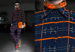 Andre Judd - Arnold Galang Matching Printed Silk Shirt And Trousers, Fluoro Orange Necklace, Fluoro Orange Satchel Worn As Clutch, Purple Fedora, Ikat Print Booties - WRAPPED LIKE AN HERMES PRESENT