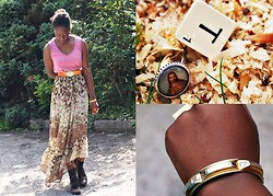 Olutosin K - H&M Flowered Layered Skirt, Brown Clasp Belt, Vero Moda Studded Pink Sleeveless Top, Charity Shop Golden Bracelet, Jesus Ring, 'T' Scrabble Ring, River Island Boots - Skirted with a Jesus ring and a Scrabble ring