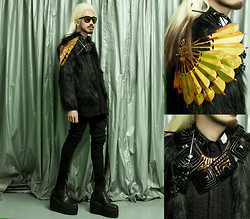 Andre Judd - H. Custodio Bronze Fan Shoulder Piece, Eric Delos Santos Chubby Faux Fur Coat, H. Custodio Black Neckpiece, Gold Zipper Neckpiece, Protacio Zippered Trousers, Topman White Hook Earring -  FUR AND FANS