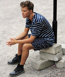 Andreas Wijk - Acne Studios T Shirt, Acne Studios Shorts, Dr. Martens Shoes - Beneath the waters.
