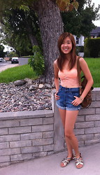Stephanie Wong - American Eagle Lace Bandeau, 7 For All Mankind High Waisted Shorts, Afaze Gold/Brown Gladiators, Boutique Gold Leather Wrap Bracelet, Prada Backpack - Casual SoCal