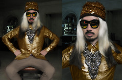 Andre Judd - Matte Gold Button Down Shirt, Gold Sequined Beanie, Joel Escober Embellished Neckpiece, Khaki Trousers - GO FOR GOLD