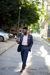 Curran J. Swint - Armstrong And Wilson Pocket Square, J. Crew Navy Suit, Bereolaesque Book, Hermës Belt - A King's Read: Bereolaesque