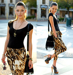 Jessica R. - Shopakira Slouchy Animal Print Pants, Daily Look Strappy Black Heels, Nasty Gal Fringe Bag, Rings And Tings Camera Necklace, Furor Moda Leather Bracelet - Magic Carpets