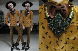 Andre Judd - Rajo X Milanos Steel Plate Boots, F&H Tanned Silk Swallow Print Shirt, Oversized Fedora, Cosmopolitan Beaded Neckpiece, Oversized Neckpiece, Lanvin Satin Bowtie, Baroque Print Jeans - DANDY SWALLOW