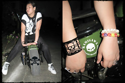 Wreyzza Swift - Thrifted Cat Shirt, Thrifted Leggings, Sneakers, Skull Cuff, Colorful Skull Bracelet, White Skull Bracelet, Chopper Bike - Chopper Bike by Robby...☠