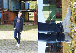Nino V. - Salvatore Ferragamo Navy Padded Jacket, Burberry T Shirt, Louis Vuitton Inventeur Belt, Nudie Jeans Skinny, Alexander Mcqueen Eagle Print Sneakers - Abandoned harbor