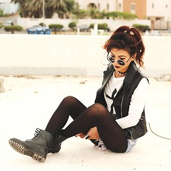 Bernadette F - Round Sunnies, Spikes Necklace, Leather Vest, Cross Print T Shirt - CHAOS
