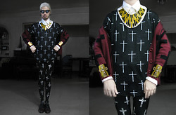 Andre Judd - Diy Cross Covered Frames, Cross Print Tee, Cross Print Leggings, D&G White Button Down Shirt, Gold Cuff With Crystal Cross, Cross Knit Cardigan Worn Off Shoulder Like A Cape/Shawl, Deadstock Vintage Laceups, Ray Of Light Neckpiece - CROSSED OUT