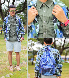 Yves Camingue - Hang Ten Contrast Stitched Shirt, Thrifted Camo Jacket, Hang Ten Denim Shorts, Gifts Unlimited Plastic Backpack, Nike High Dunks, Oakley Solarized Sunglasses - Camo Nimrod