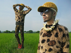 Andre Judd - Cosmopolitan Furry Cap With Spikes, Furry Sweater, Os Hoof Neckpiece, Vintgae Tiger Print Leggings, Madonna Concert Tee, Tapestry Print Leather Booties - FIELD OF DREAMS