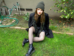 Allysa Stone - Second Hand Black Coat, Urban Outfitters Green Plaid Scarf, Levi's® Grey Shorts, Dr. Martens - Earth