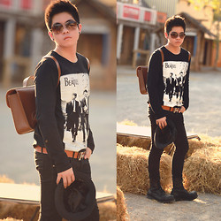 Guy Rachtasaevee - Ray Ban Aviator, Cambridge Satchel Backpack, Underground Boots, Hermës H Buckled Belt, The Beatles Shirt, Levi's® Black Jeans, Hat - Blackbird
