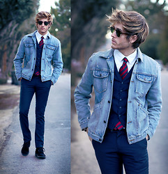 Adam Gallagher - Similar Here  > Jean Jacket, Similar Here  > Tie, Similar Here  > Vest, Similar Here  > Trousers, Similar Here  > Boots - Refining le jean