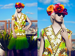 Andre Judd - H. Custodio Floral Embellished Cap, H. Custodio S/S2013 V Neck Floral Shirt, H. Custodio S/S 2013 Grass Skirt, Black Jeans, H. Custodio Black Frames - GRASS ROOTS