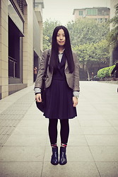 Yan Chen -  - Formal look with cool boots