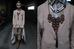 Andre Judd - Guy Laroche Vintage Structured Blazer With Flap Panel, Tribal Neckpieces, Tassell Necklace, Woven Cap, Round Frames, Viktor Beige Trousers, Don Protasio Crushed Cotton Trapeze Top - GOING NUDE