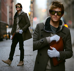 Adam Gallagher - Similar Here  > Gloves, Coat, Knit Sweater, Similar Here  > Black Skinny Jeans, All Saints Boots, Similar Here  > Yellow Mirror Sunnies - Reflective in SoHo